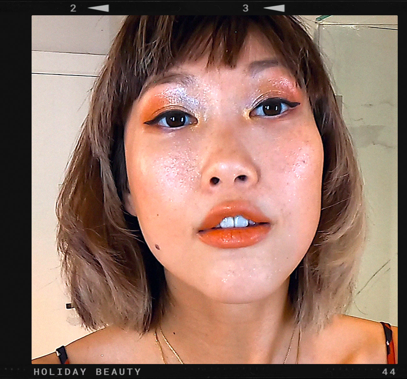 Model Angie Ng doing a make-up tutorial video