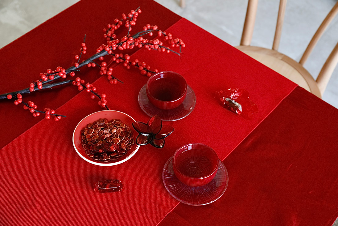 Chinese New Year table styling showing bold colours and textures