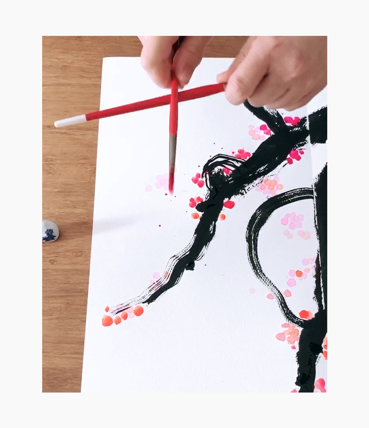 An artist creating a Chinese New Year calligraphy couplet