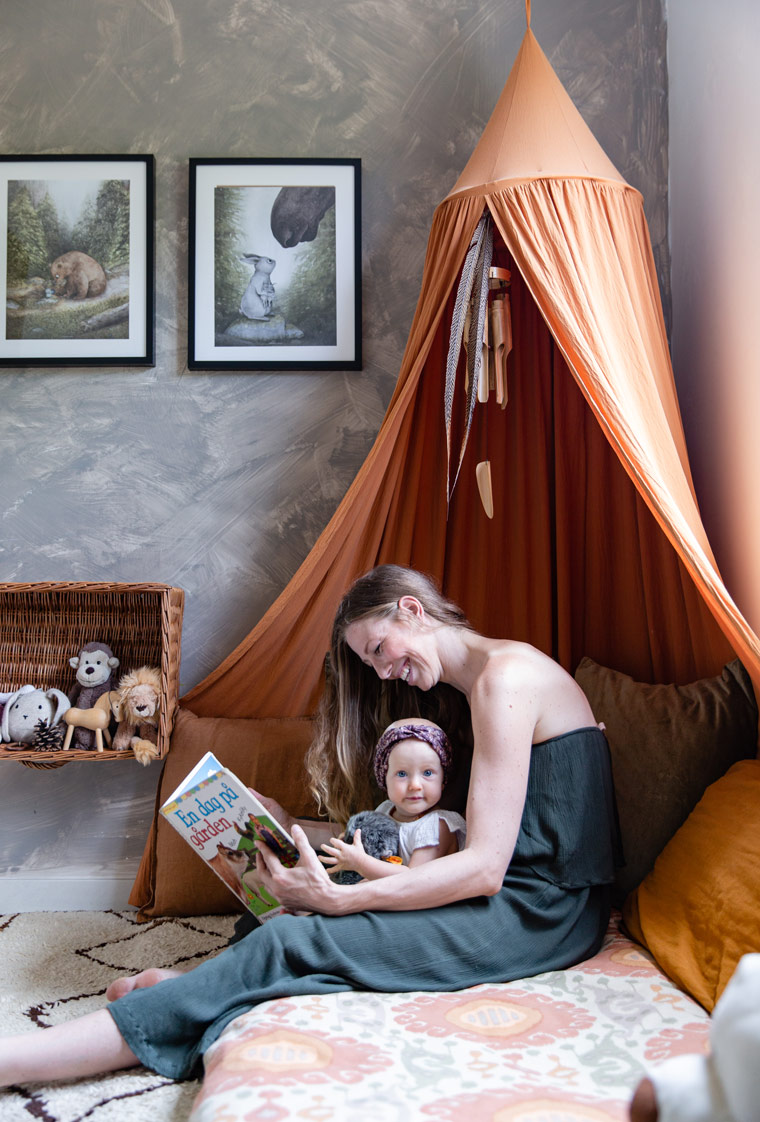 Cecilie Kock Larsen shares a moment with her daughter in a tepee