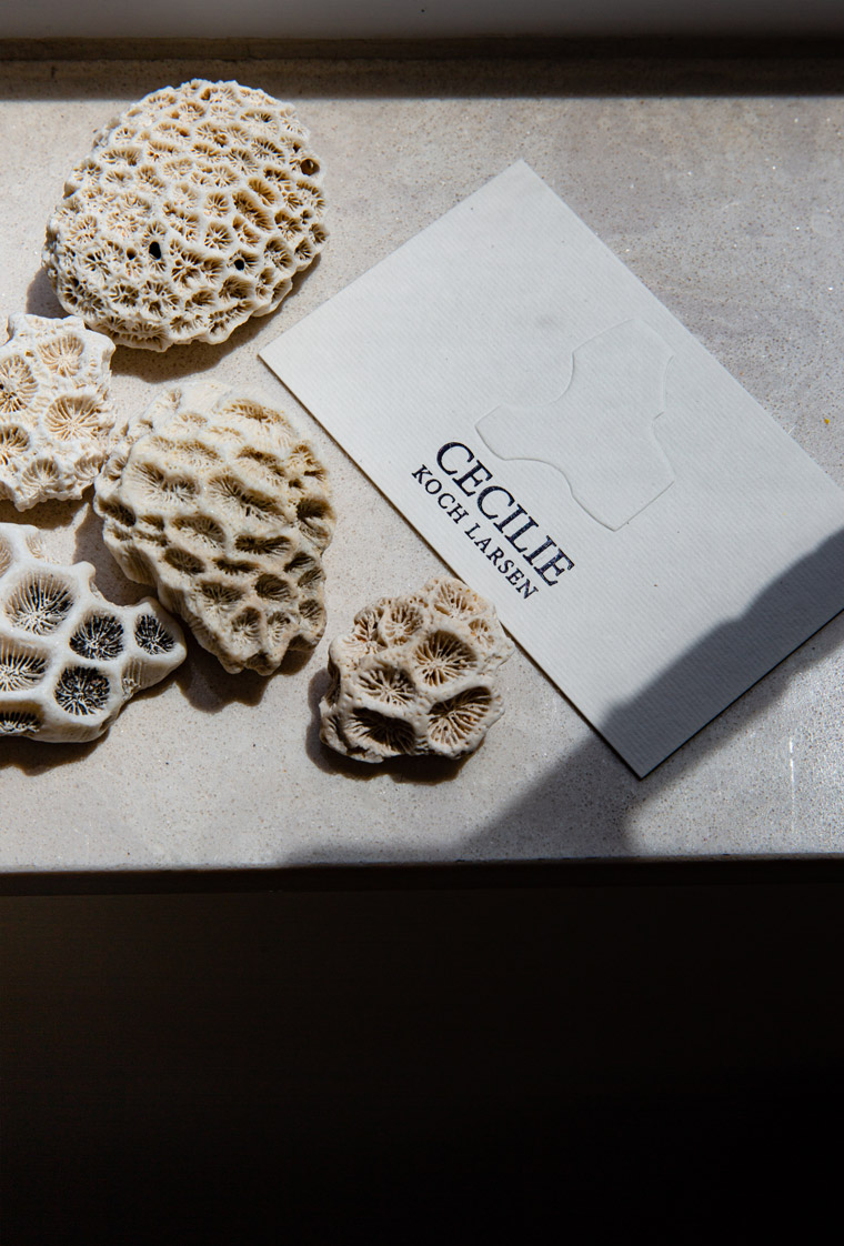 A business card and found objects in Cecilie Koch Larsen's home