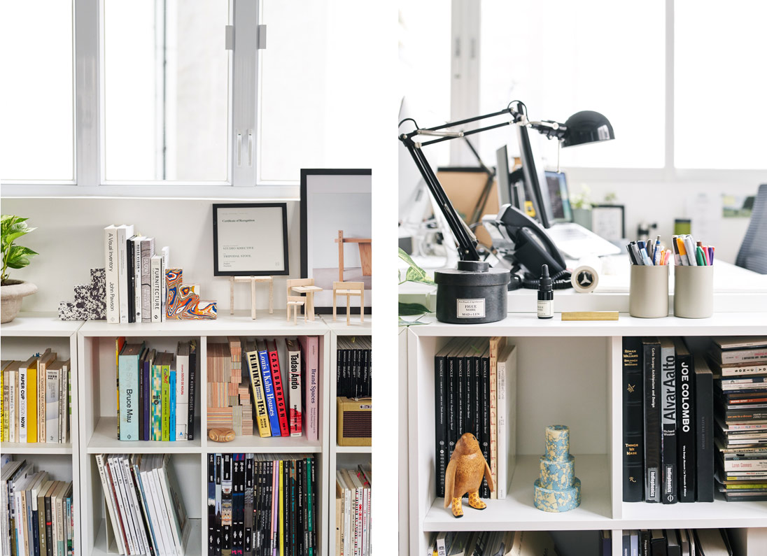 A shelf displays books and knick-knacks, including Tom Dixon's Swirl Stepped Candle Holder and Swirl Bookend