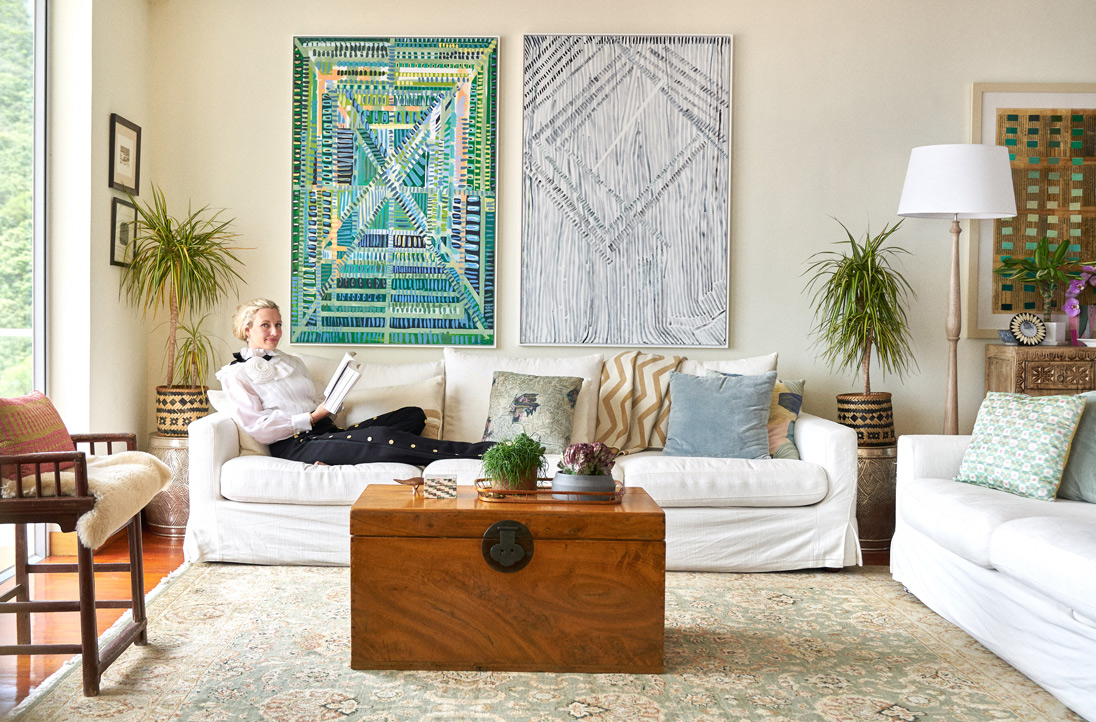 Artist and interior designer Greer Howland Smith lounges at her Southside home wearing Edward Achour frill blouse and wide-leg pants, available from Harvey Nichols