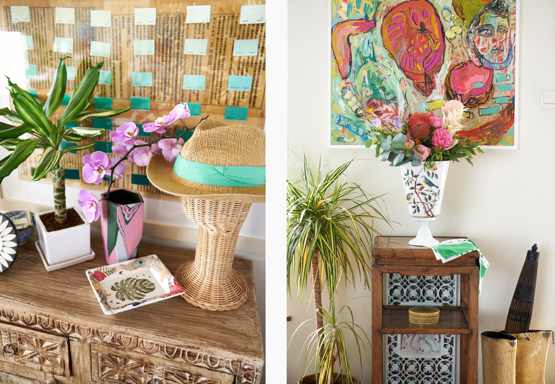Left: The home is peppered with colourful accents, including a tray from La Cartuja de Sevilla and a vase from Elyse Graham, both available at Lane Crawford. Right: An Astier de Villatte x John Derian vase from Lane Crawford and a floral bouquet from Ellermann perch in front of Greer's own artwork to create a pretty contrast of print and colour