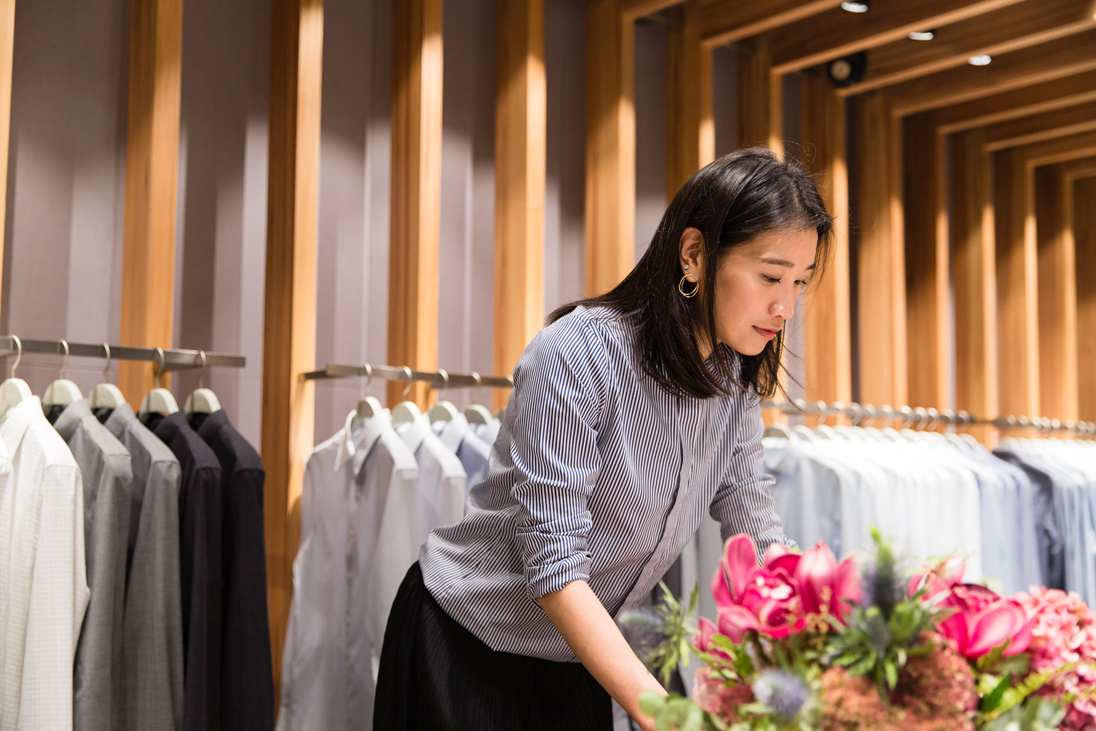 Dee adjusting merchandise at PYE's Pacific Place store