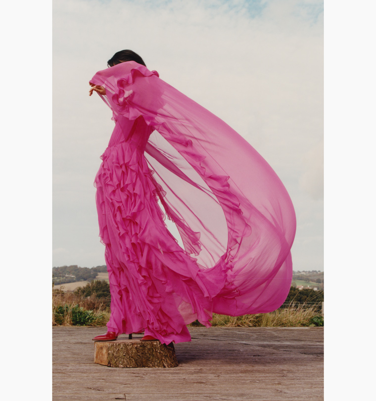 A model's pink Valentino gown flutters in the breeze