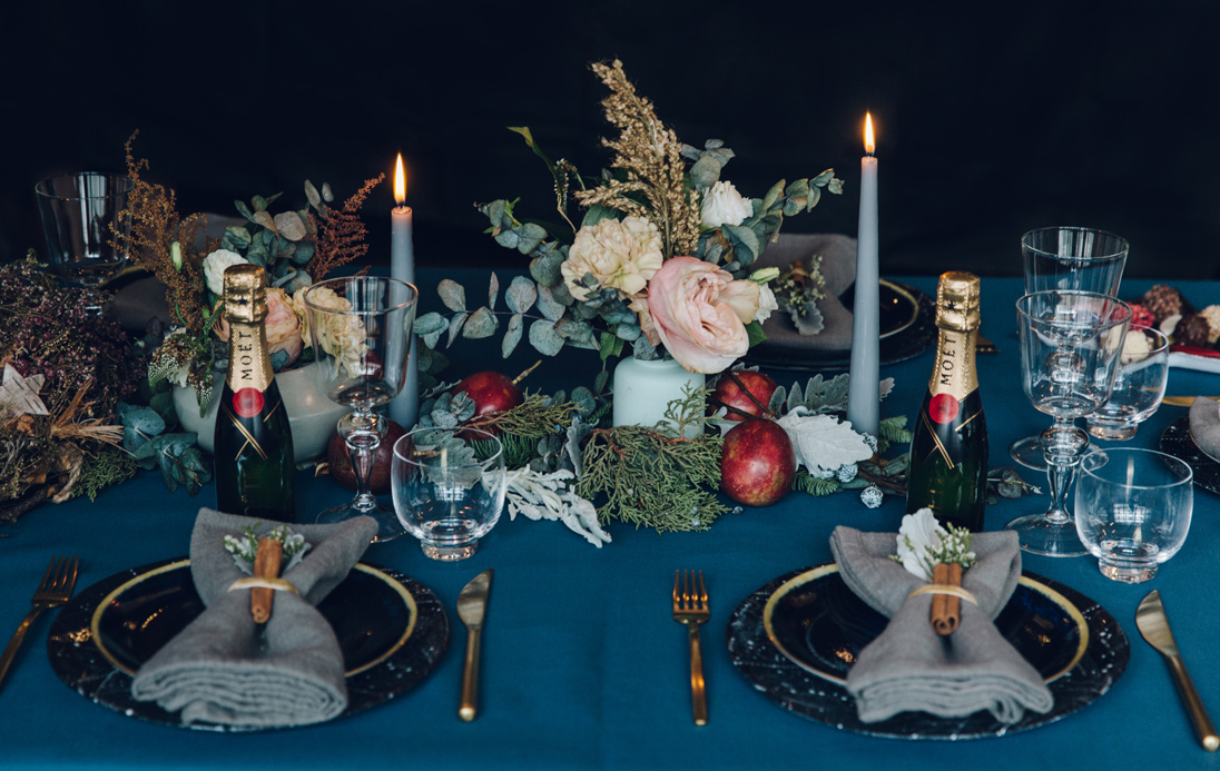 Candles and flowers are the focal points of the tablescape