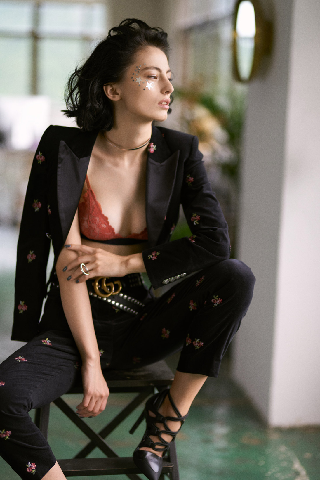 Model poses in a modern pant suit from The Kooples and bralette from COS