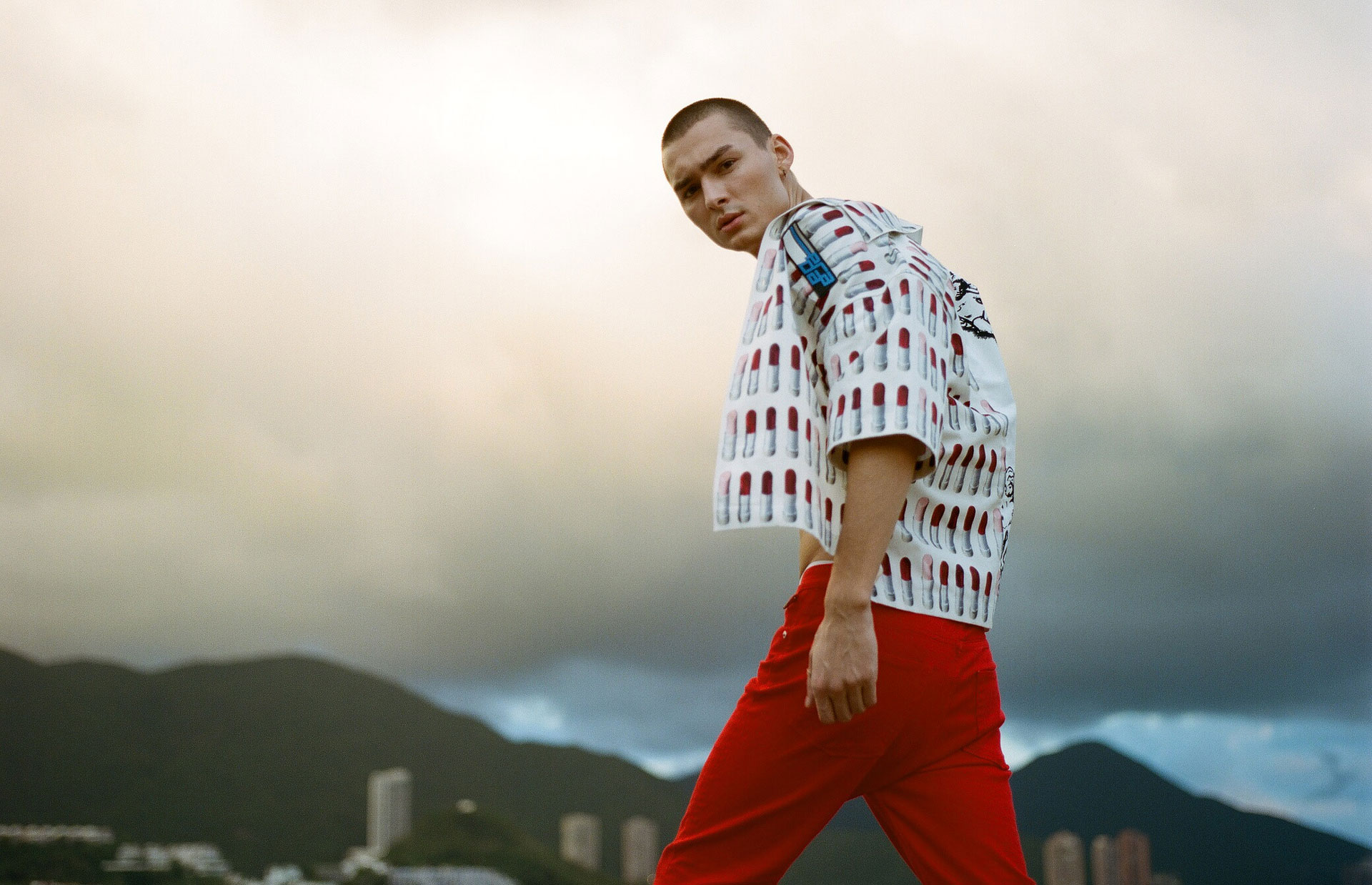 Model pairs a printed Prada shirt with trousers from Zadig & Voltaire