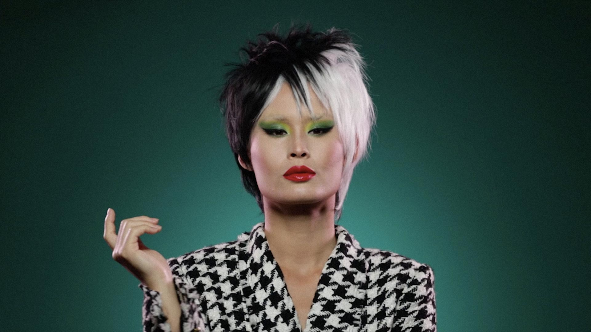 A model made up as Cruella de Vil from 101 Dalmatians
