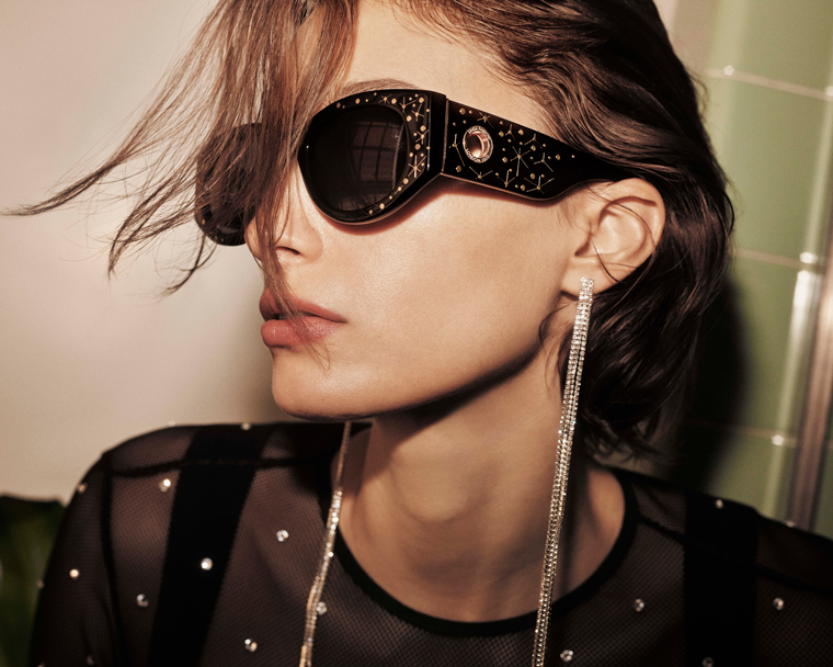 A model wearing Linda Farrow Debbie sunglasses