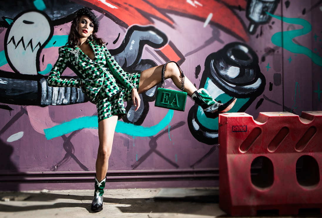 A model poses in front of graffiti wearing Emporio Armani