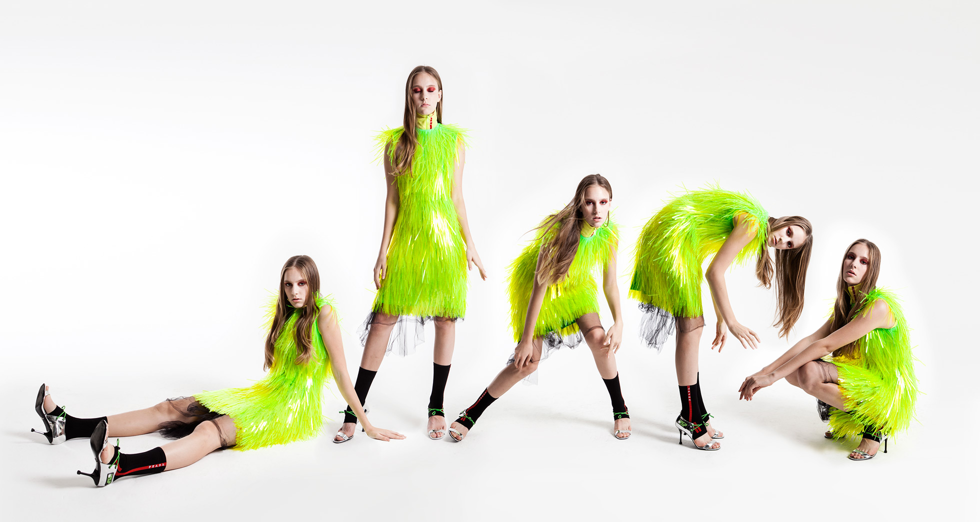 A model poses in a neon fringe Prada look