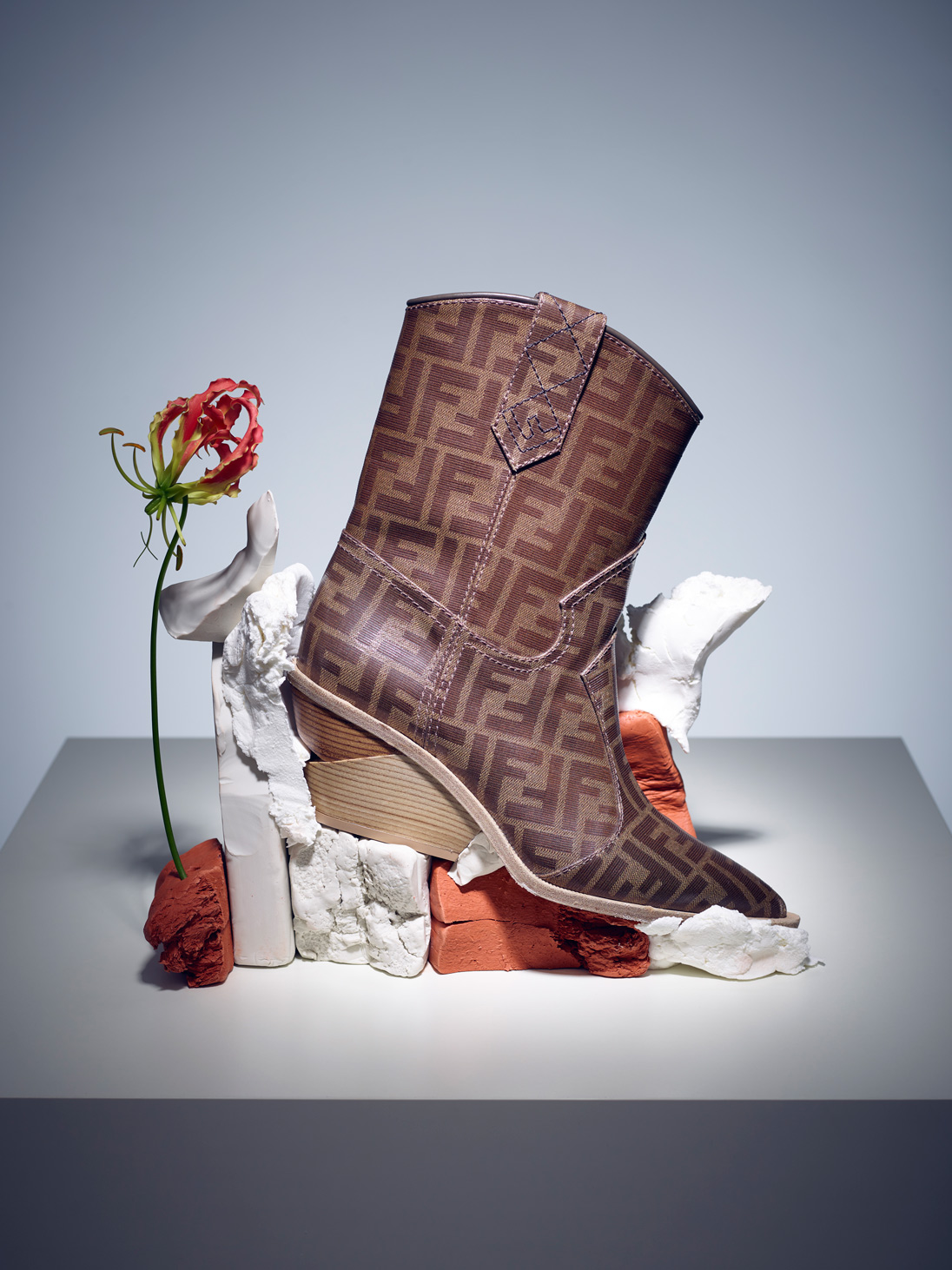 Today the cowboy boot represents adventure, and that mood is neatly summed up in Fendi's glazed logo-motif pair