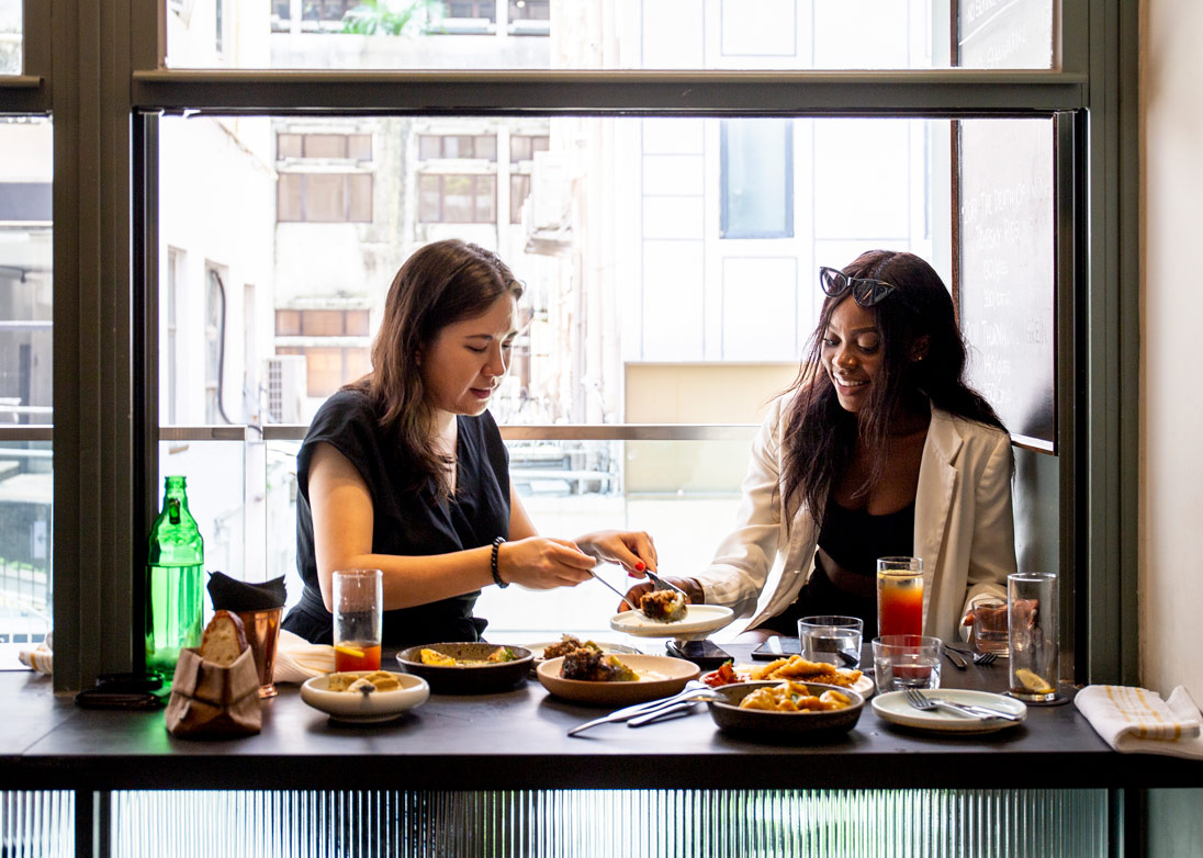 Writer Tegan Smyth and Harmony HK founder Anne-Marie 'Harmony' Ilunga tuck into a Sunday lunch at Francis in Starstreet Precinct