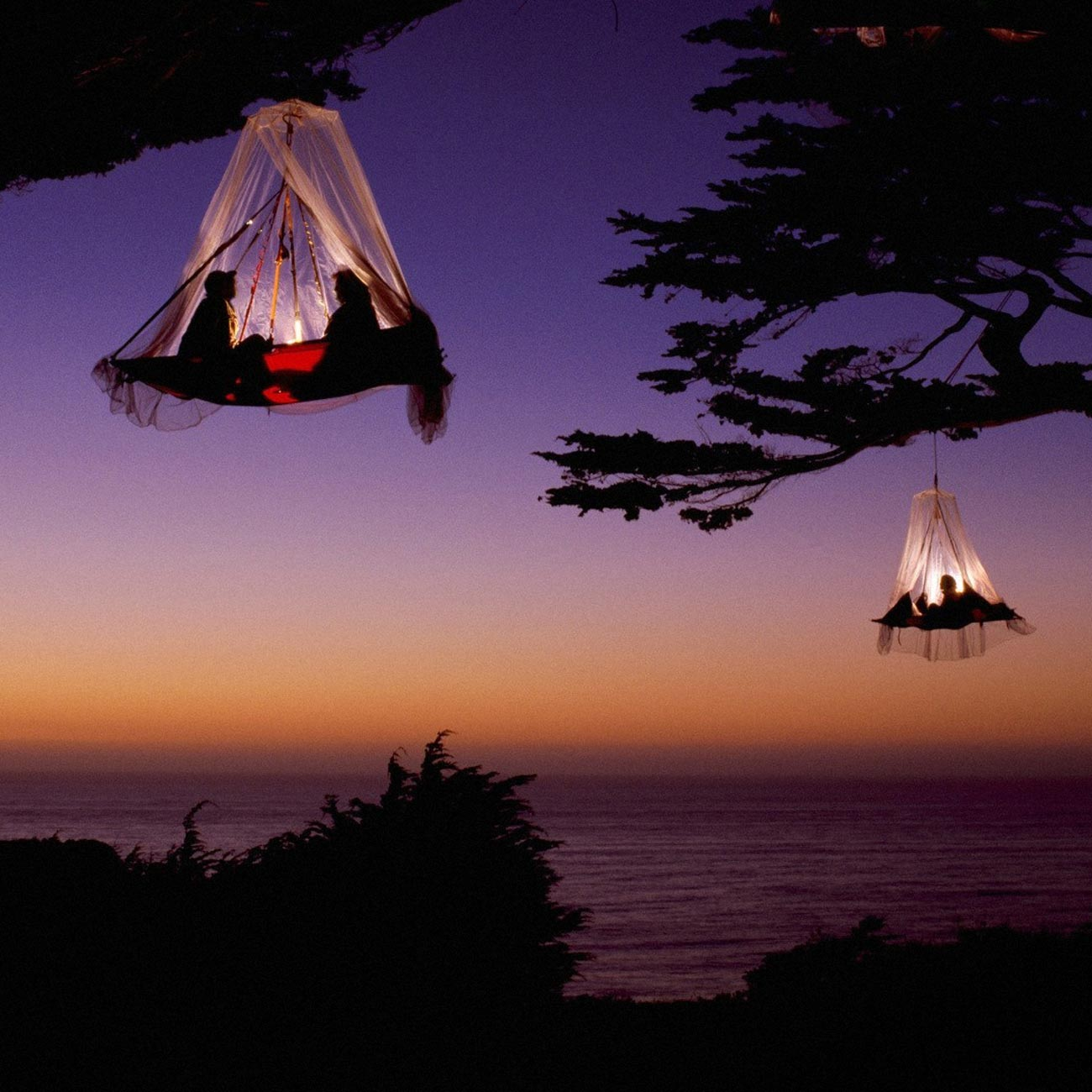 Travellers sleeping in dangling tents
